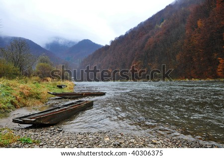 Wood raft in fall landscape - stock photo
