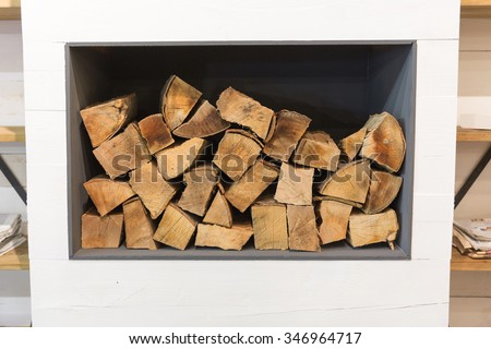 Wood ready for fireplace in the home interior - stock photo