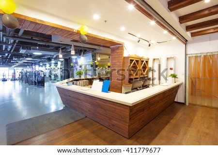 wood reception desk in modern gym - stock photo