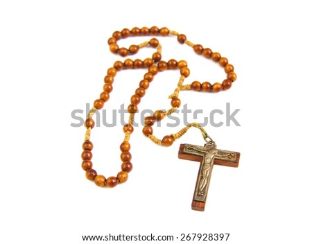 Wood rosary and cross with slightly unfocused beads isolated on white background - stock photo