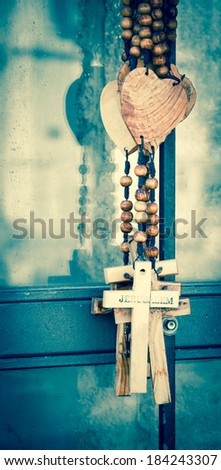 Wood rosary with the heart and the cross with inscription JERUSALEM. Closeup. Retro aged photo. - stock photo