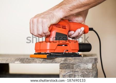 Wood sanding - stock photo