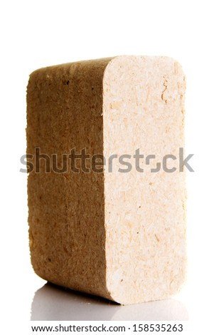 Wood sawdust briquettes , isolated on white - stock photo