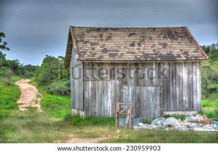 Wood shack in the middle of a farm field in the Brazilian countryside - stock photo