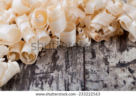 Wood shavings o0n a wooden background - stock photo