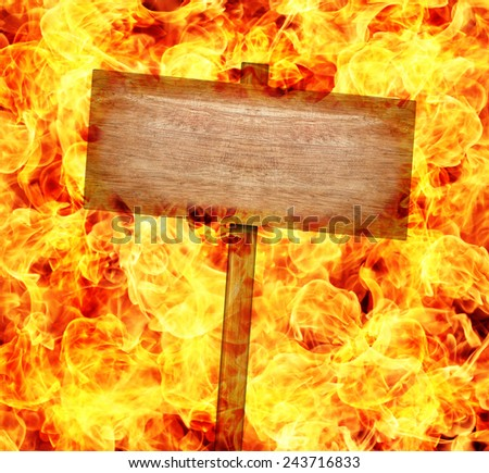 Wood Sign and Flames isolated on black background. - stock photo