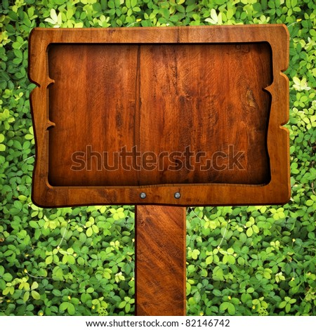 wood sign with grass background - stock photo