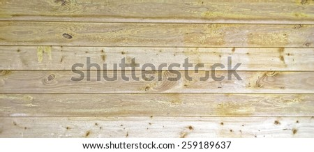 Wood slats and planks in a barn building in Devon UK, showing the grain and rough cut surface, grain is present due to rough finish of wood - stock photo