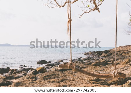wood swing on the  beach. vintage filter effect - stock photo