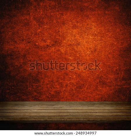 Wood table and red concrete wall background - stock photo