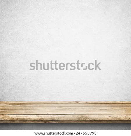 Wood table and white concrete wall background - stock photo
