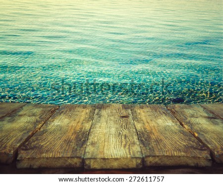 Wood table. Summer background. Ocean ripples. Holiday nature background. - stock photo