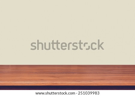 Wood table top on vintage color background - can montage or display your products on top - stock photo
