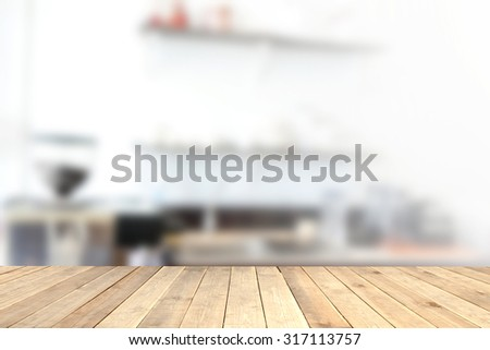 Wood table top with blurred of coffee shop background - can be used for montage or display your products - stock photo