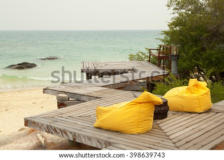 wood terrace with yellow bean bag and beautiful scenery - stock photo