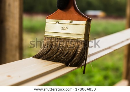 Wood texture and paintbrush / housework background - stock photo