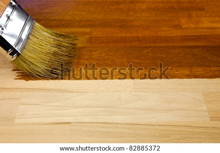 Wood texture and paintbrush / housework background - stock photo