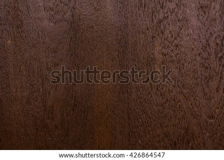 wood texture - brown blank plank surface shiny wooden wall floor frame exterior panel timber material background closeup - stock photo