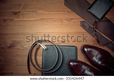 wood texture. Men's everyday objects on a dark background. business meeting. Accessories for the business of the day. - stock photo