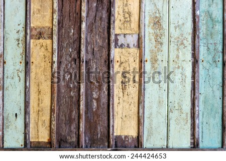 Wood texture with painting color peeled off. - stock photo