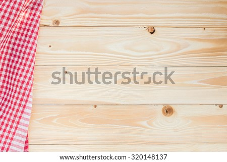 wood texture with red squared textile napkin, top view, horizontal - stock photo