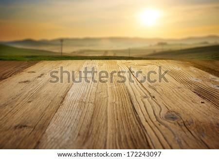 wood textured backgrounds on the tuscany landscape background - stock photo