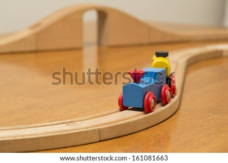 wood train toy with bridge in background - stock photo