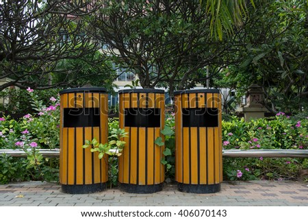 Wood trash bin in the garden - stock photo