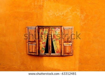 Wood window on orange cement wall - stock photo