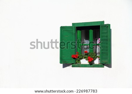 Wood window painted green isolated on a white wall - stock photo