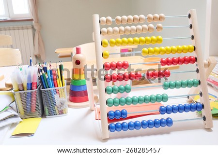 Wooden abacus with many colorful beads - stock photo