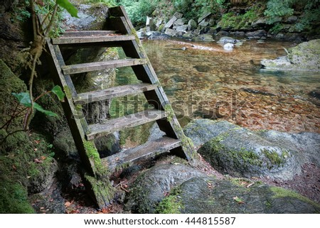 Wooden access steps to the East Lyn River, Lynmouth, Exmoor, Devon, England. - stock photo