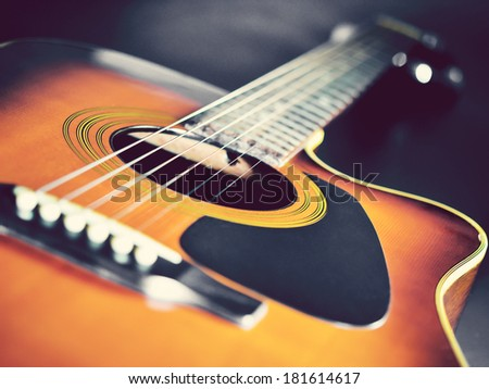 wooden acoustic guitar in vintage tone  - stock photo