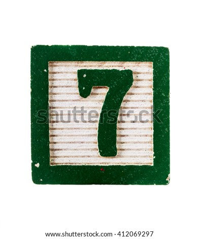 Wooden alphabet block with number 7 isolated on white - stock photo