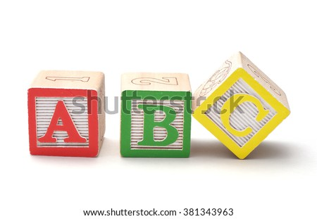 Wooden alphabet blocks isolated on white background - stock photo