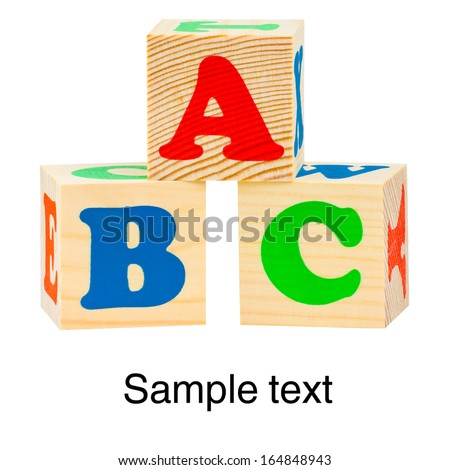 Wooden alphabet blocks isolated on white background with copy-space. ABC letters - stock photo