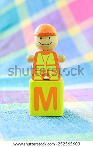 Wooden alphabet blocks toy - stock photo