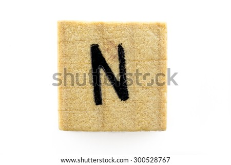 Wooden alphabet blocks with letters N (Isolated) - stock photo