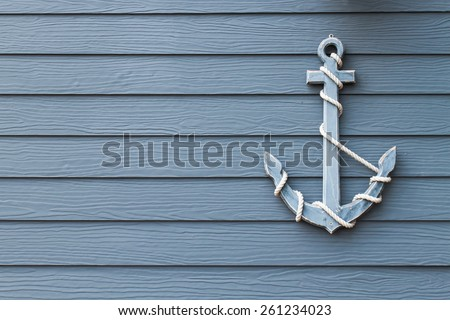 wooden anchor on wall background - stock photo