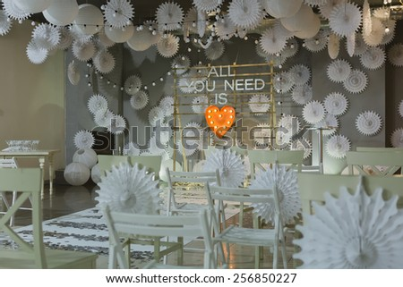 wooden arch and chairs at wedding ceremony - stock photo