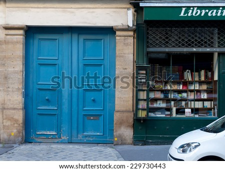 Wooden arch entry door and book store front - Paris, France - stock photo