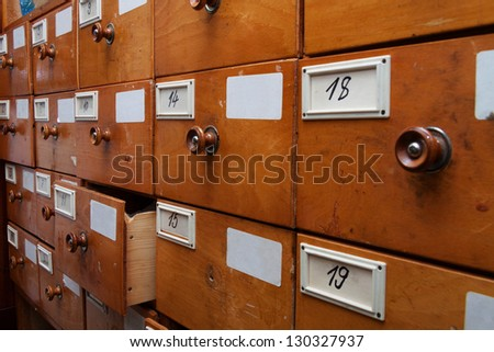 Wooden archive drawers, side view - stock photo