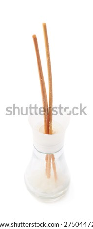 Wooden aroma sticks in a glass jar isolated over the white background - stock photo