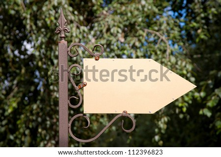 Wooden arrow cursor on a metal pole. Ready for your labels, logo or symbol. - stock photo