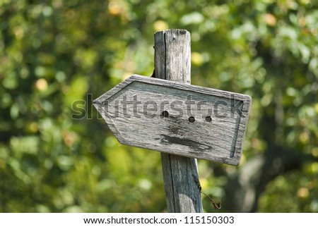 wooden arrow road sign - stock photo