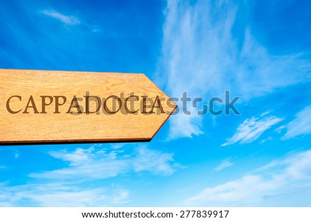 Wooden arrow sign pointing destination CAPPADOCIA, TURKEY against clear blue sky with copy space available. Travel destination conceptual image - stock photo