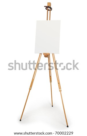 wooden artist easel with blank canvas isolated on white - stock photo