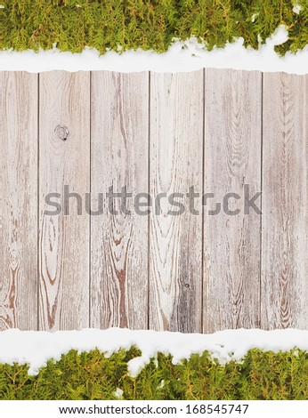 Wooden background with branches of Christmas tree, - stock photo