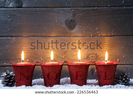 Wooden background with Christmas candles - stock photo