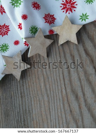 wooden background with fabric and stars - stock photo